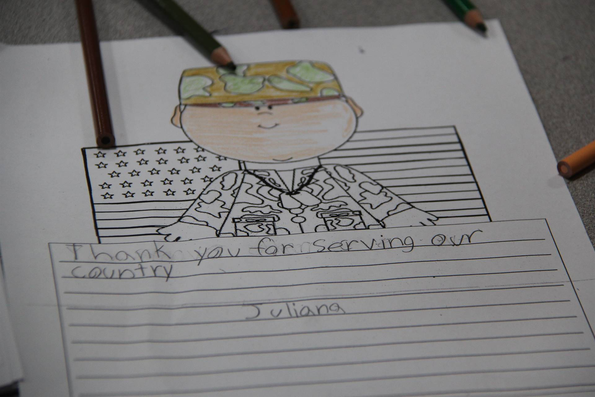 colored in letter of military member that says thank you for serving our country