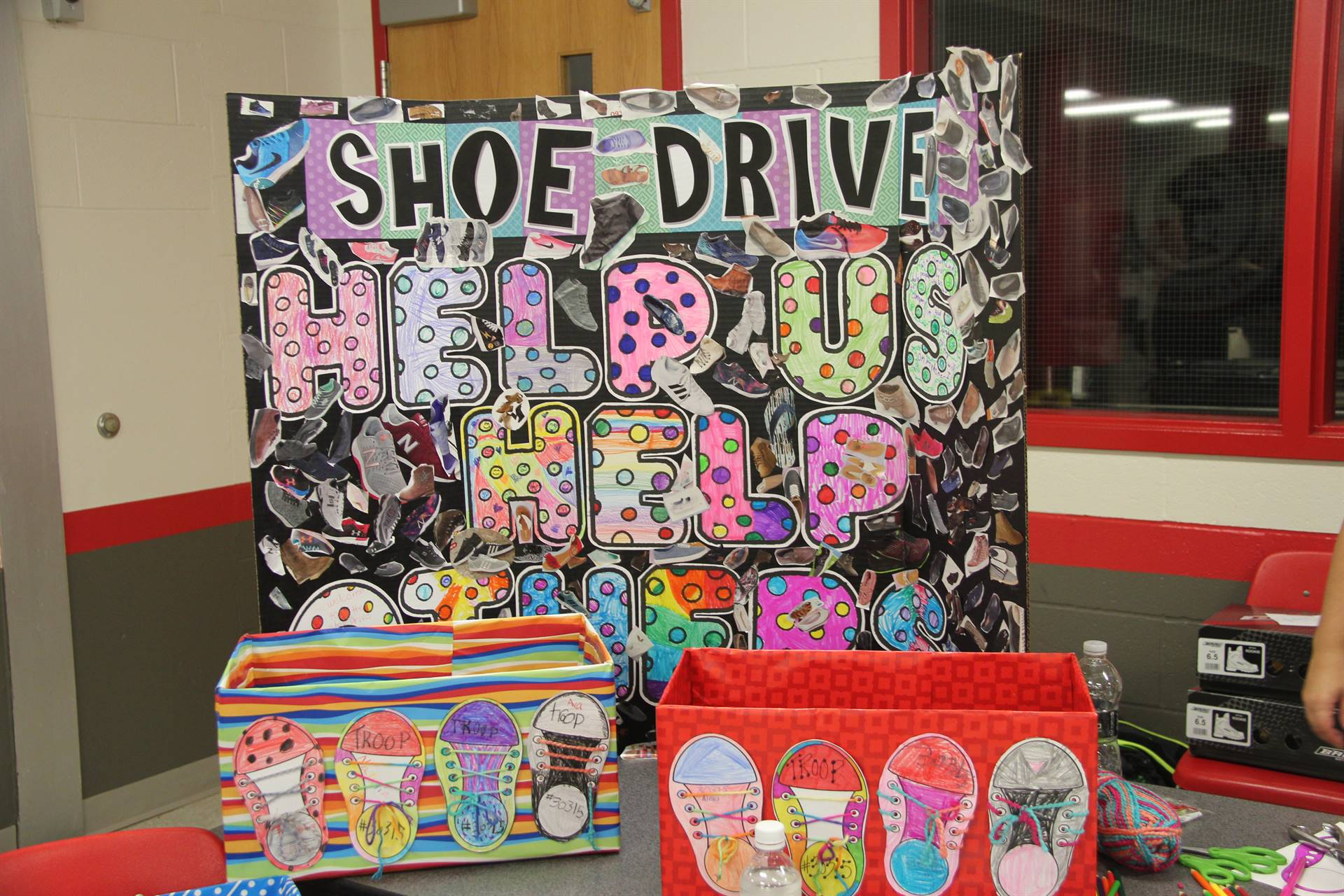 colorful sign that says shoe drive help us help others