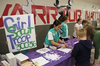 girl scout table at humanities night