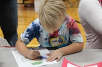 boy coloring in picture