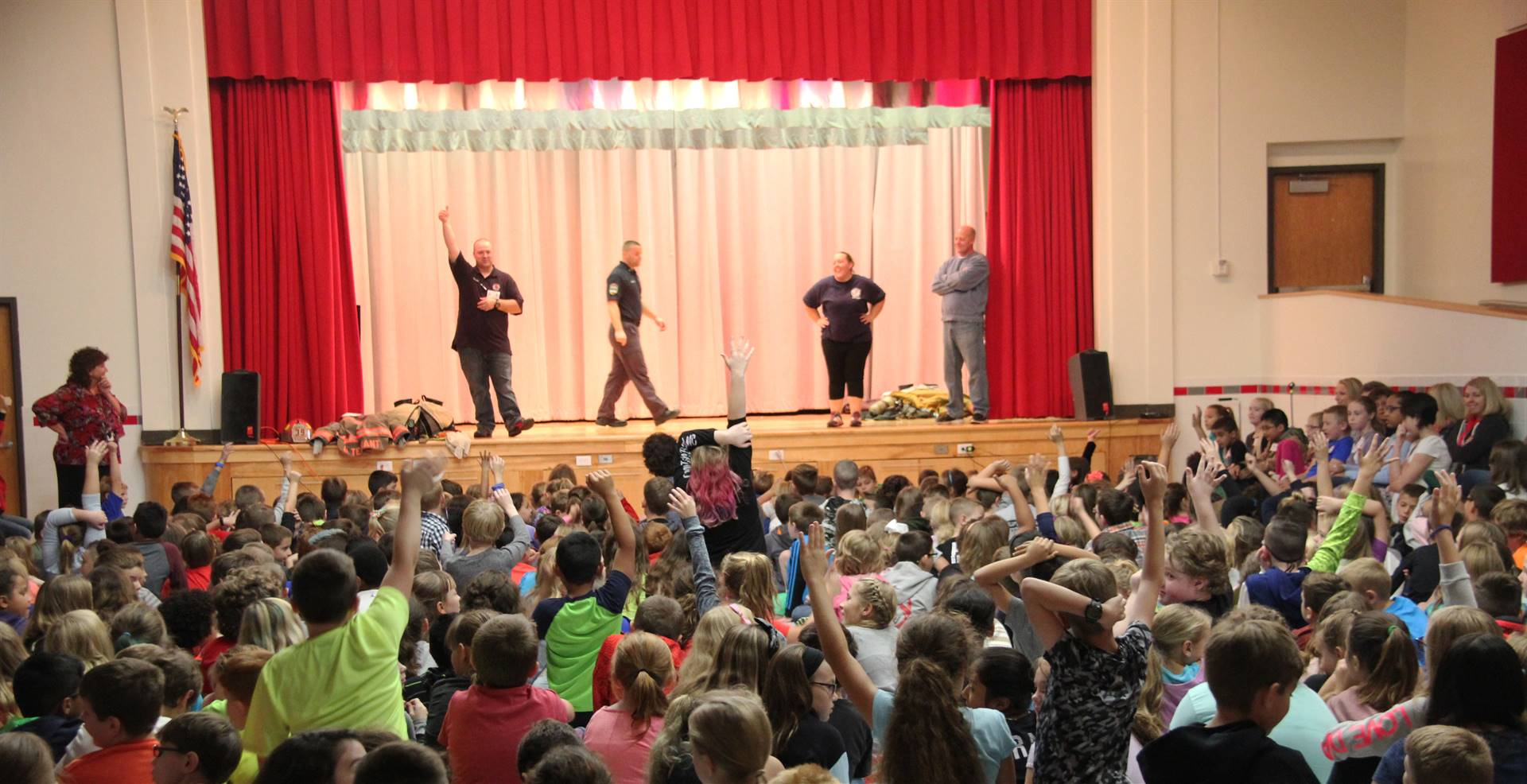 students raise hands to ask questions at chenango bridge fire safety assembly