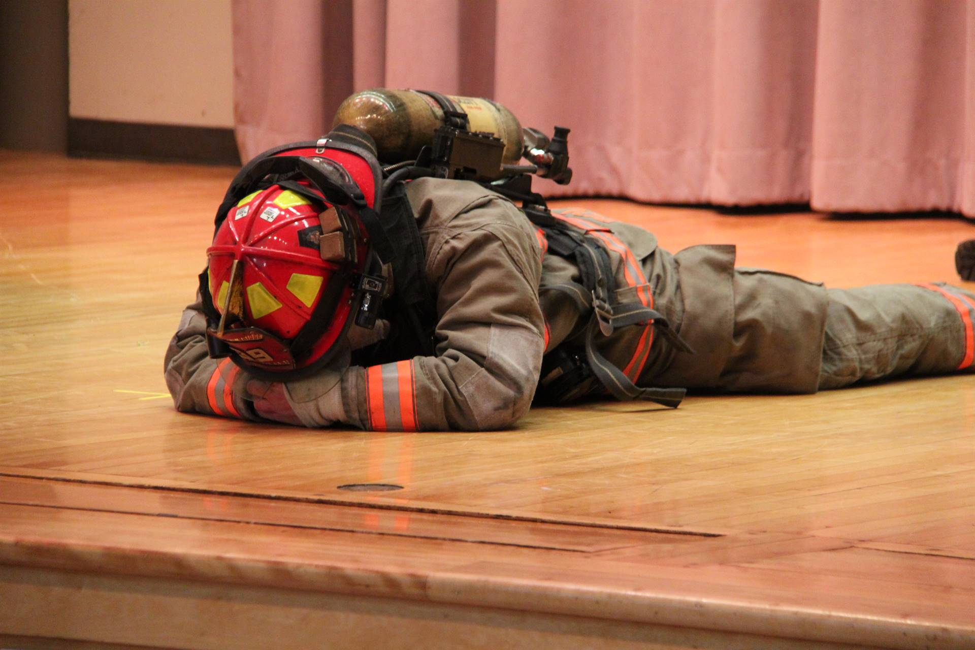 firefighter demonstration laying on floor