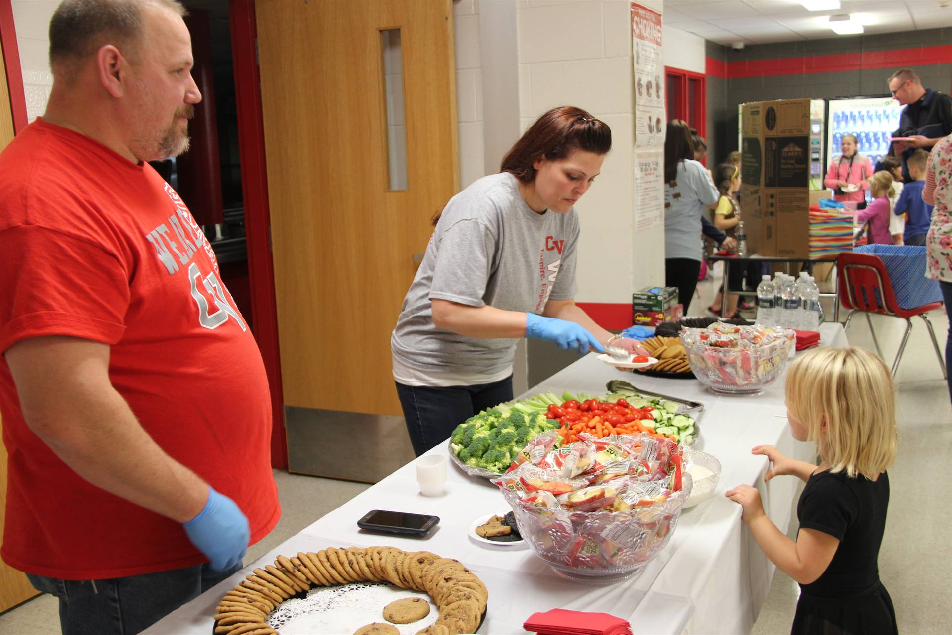 staff helping to serve food at humanities night