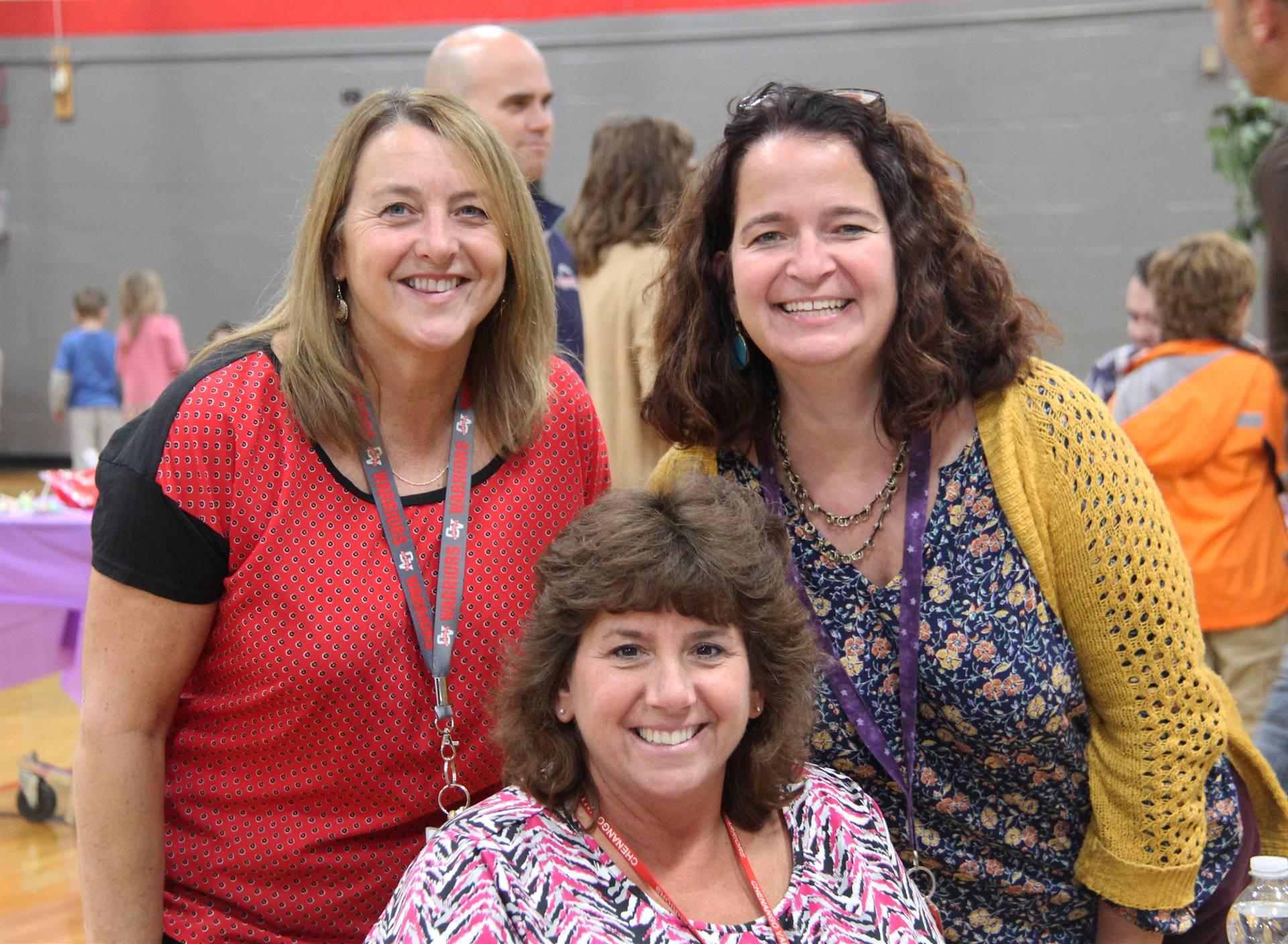 three c v staff members at humanities night