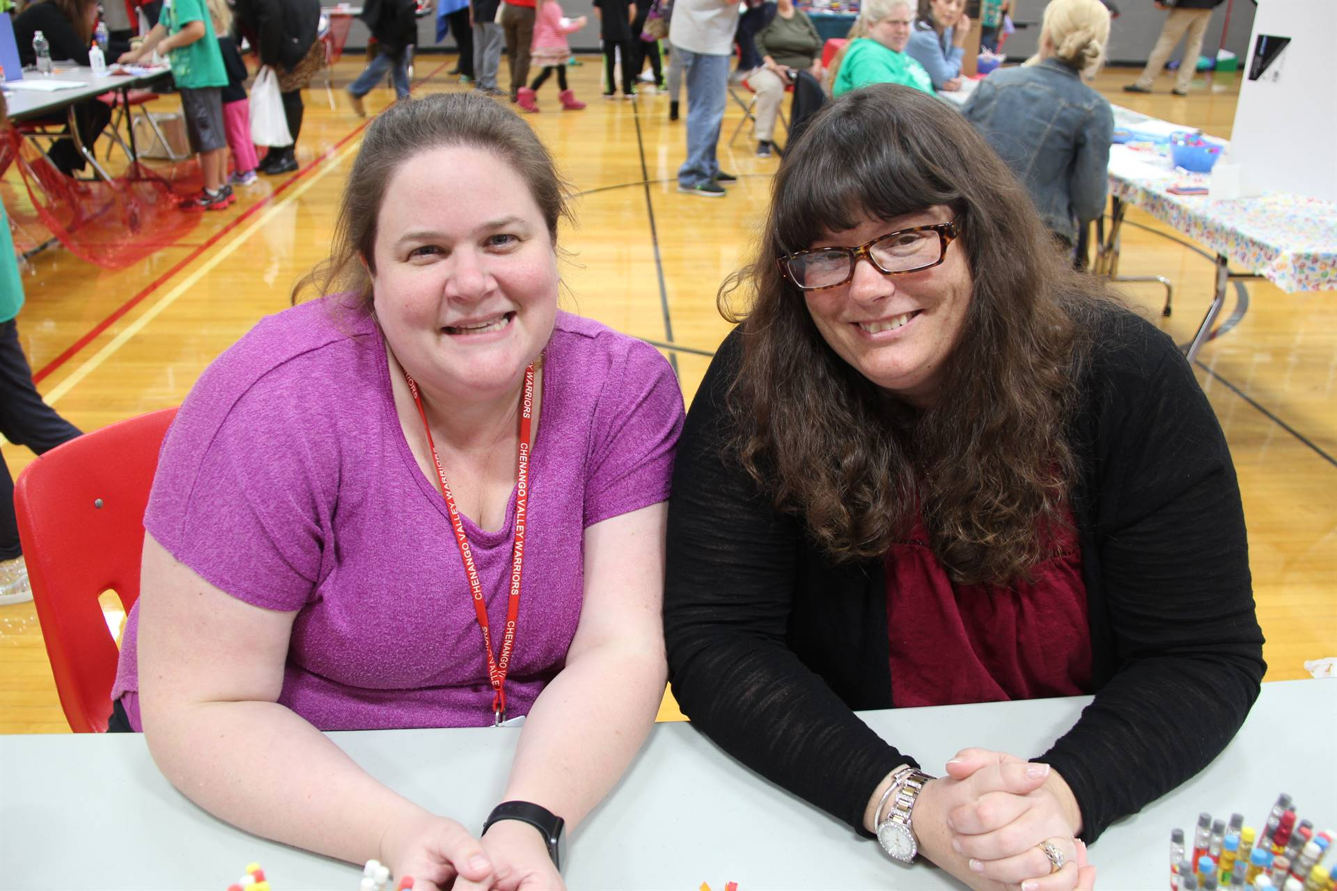two c v staff members at welcoming table at humanities night