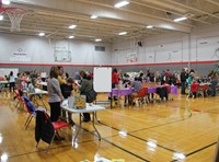 wide shot of the middle school gym filled with people for humanities night