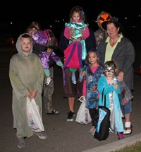 group dressed up for trunk or treat event