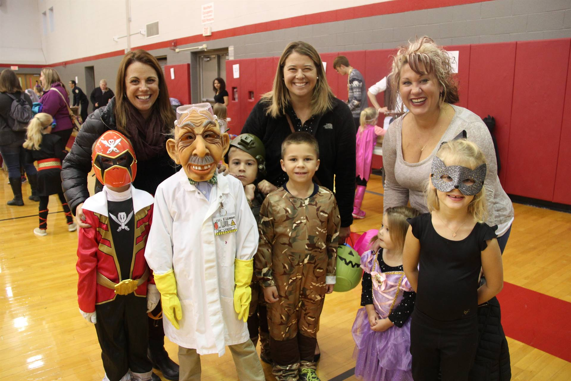 group of parents with students dressed in costumes