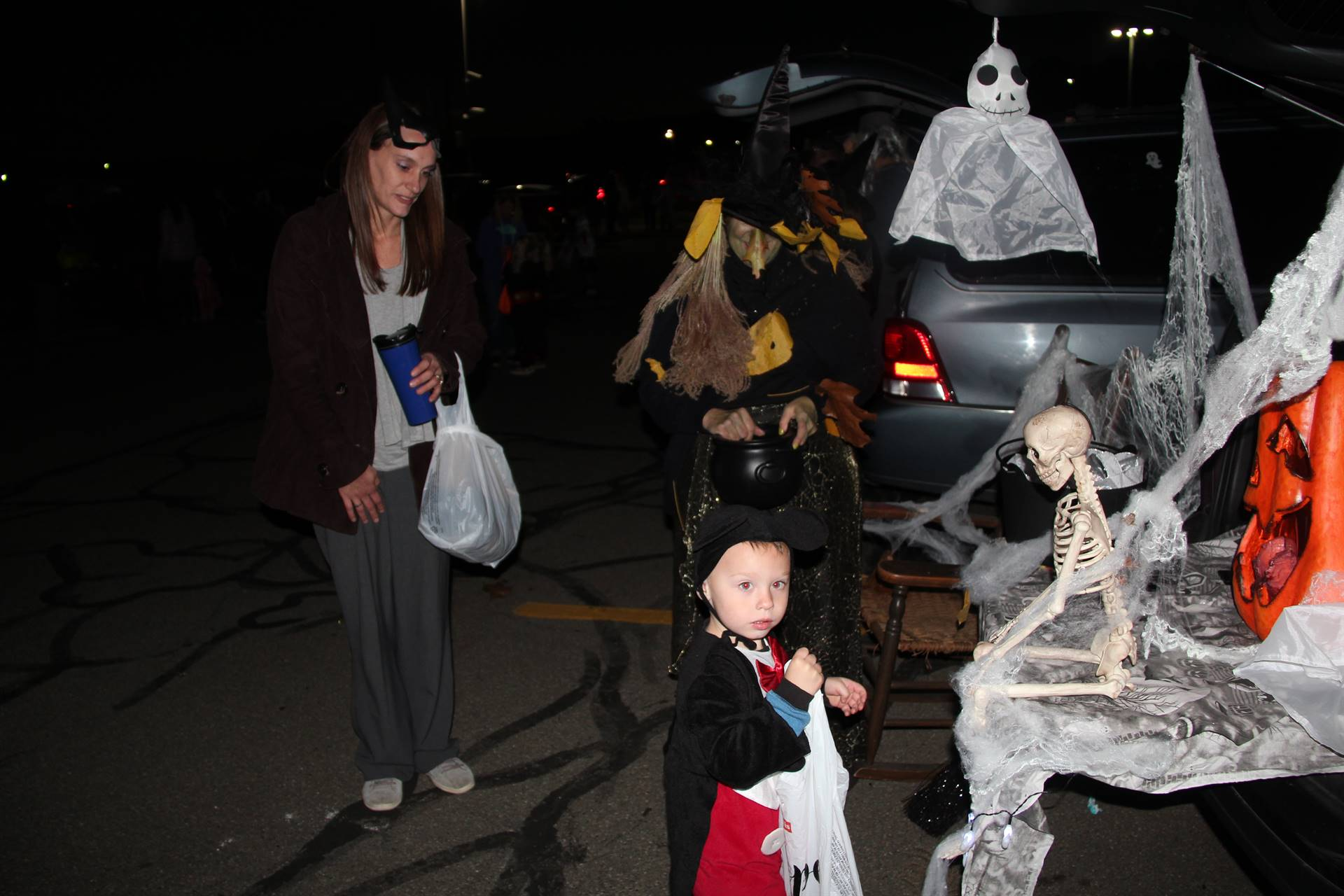 child dressed up at trunk or treat event