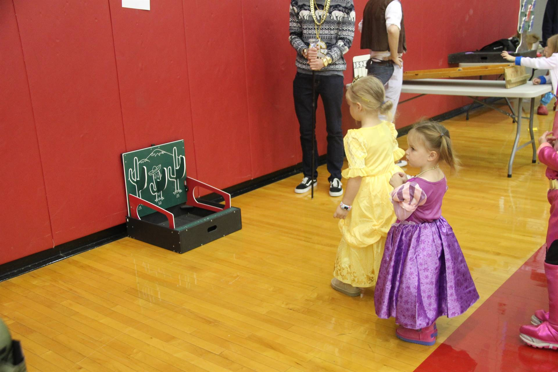 little girls dressed as princesses playing game
