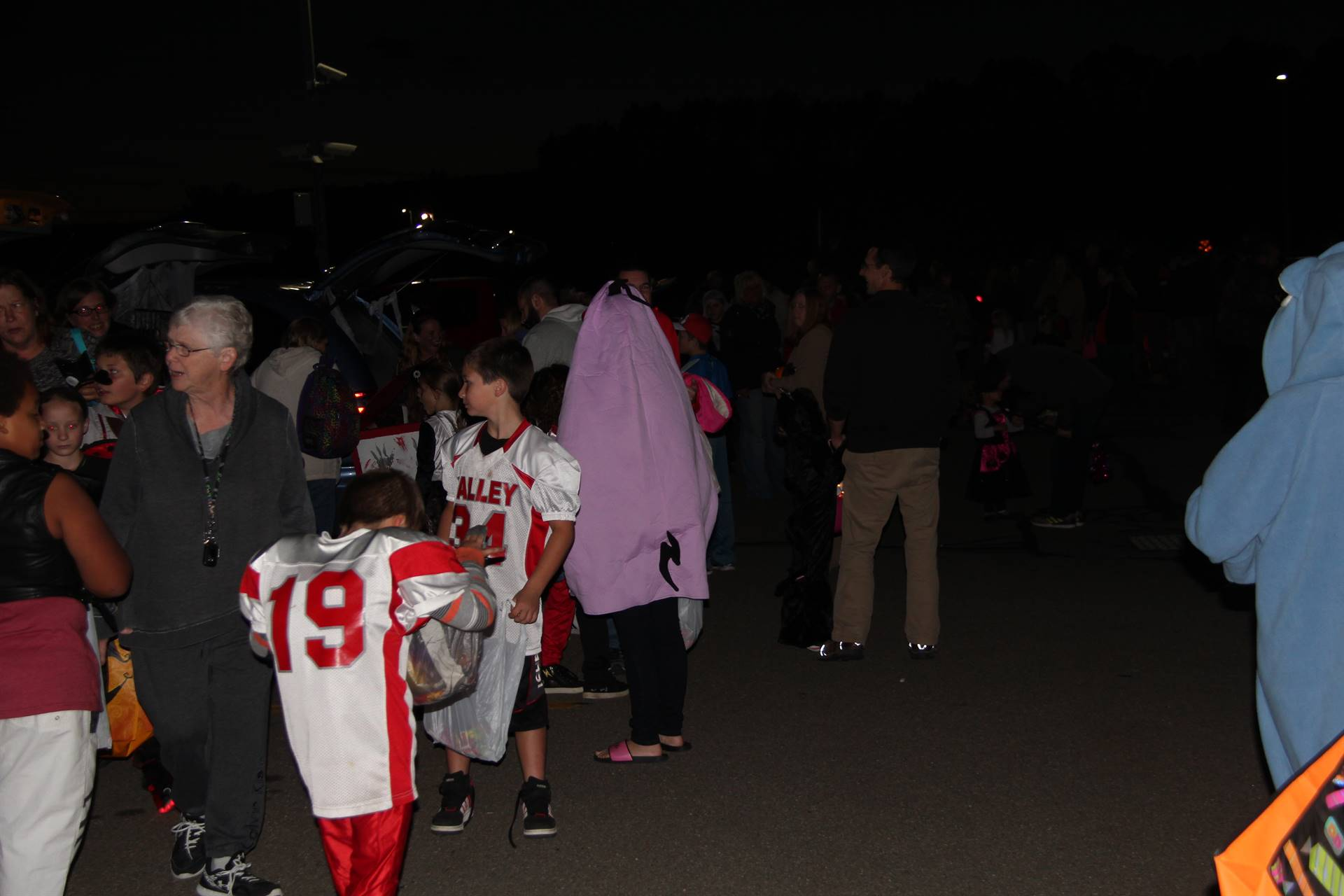 people outside at trunk or treat event