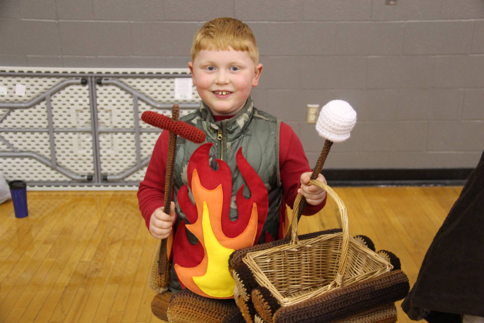 student dressed as a campfire