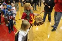 student dressed as campfire and smores parade around gym
