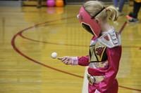 girl dressed as pink power ranger playing game