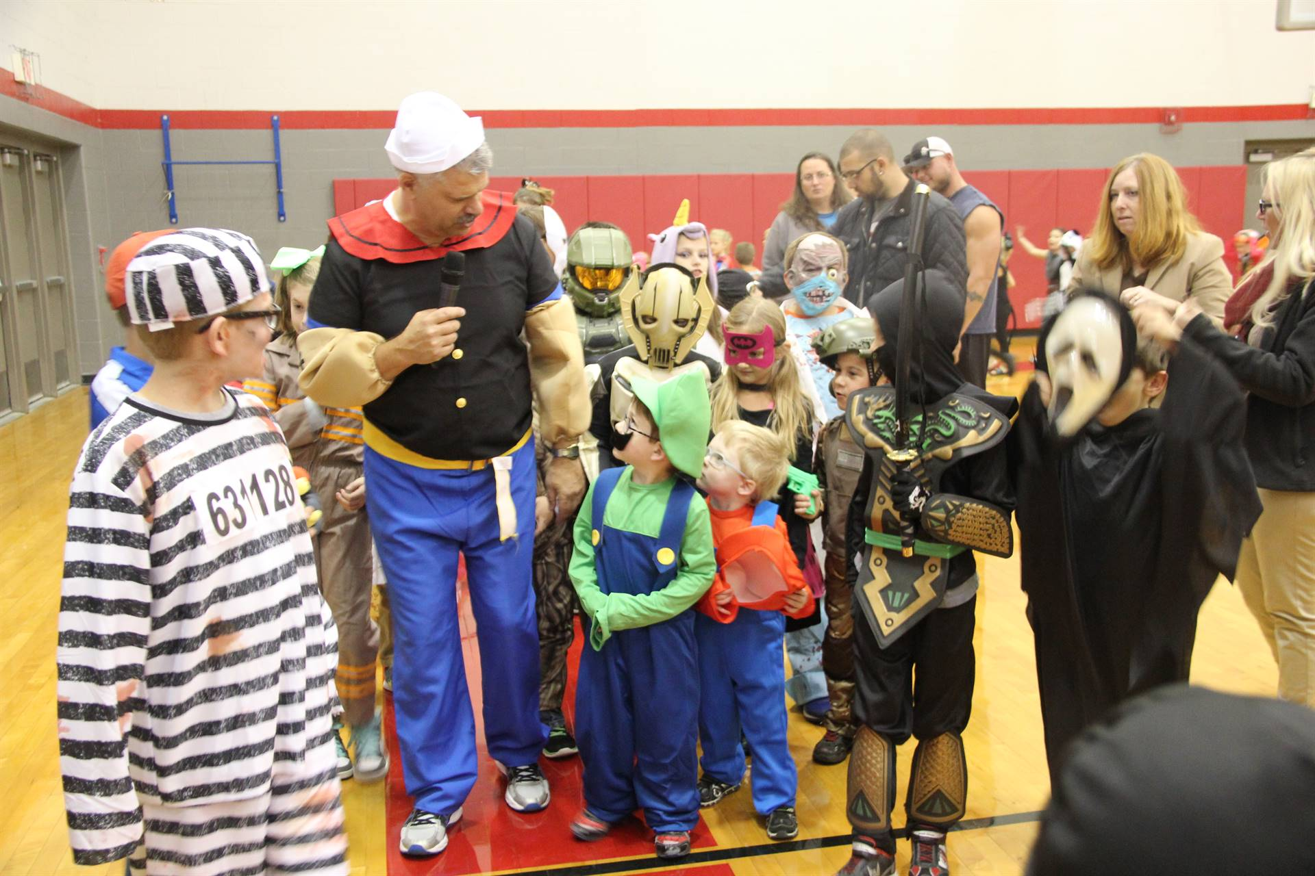 students in parade with mister krause at halloween event