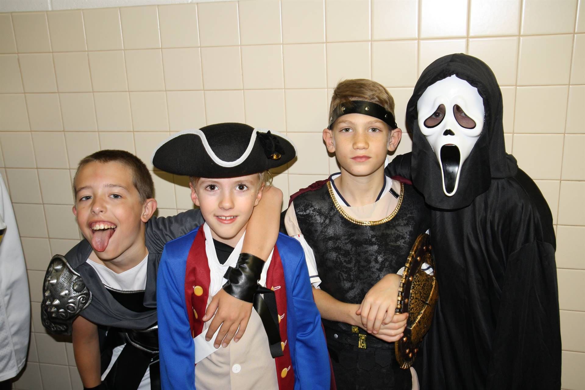 four male students dressed for halloween at chenango bridge elementary