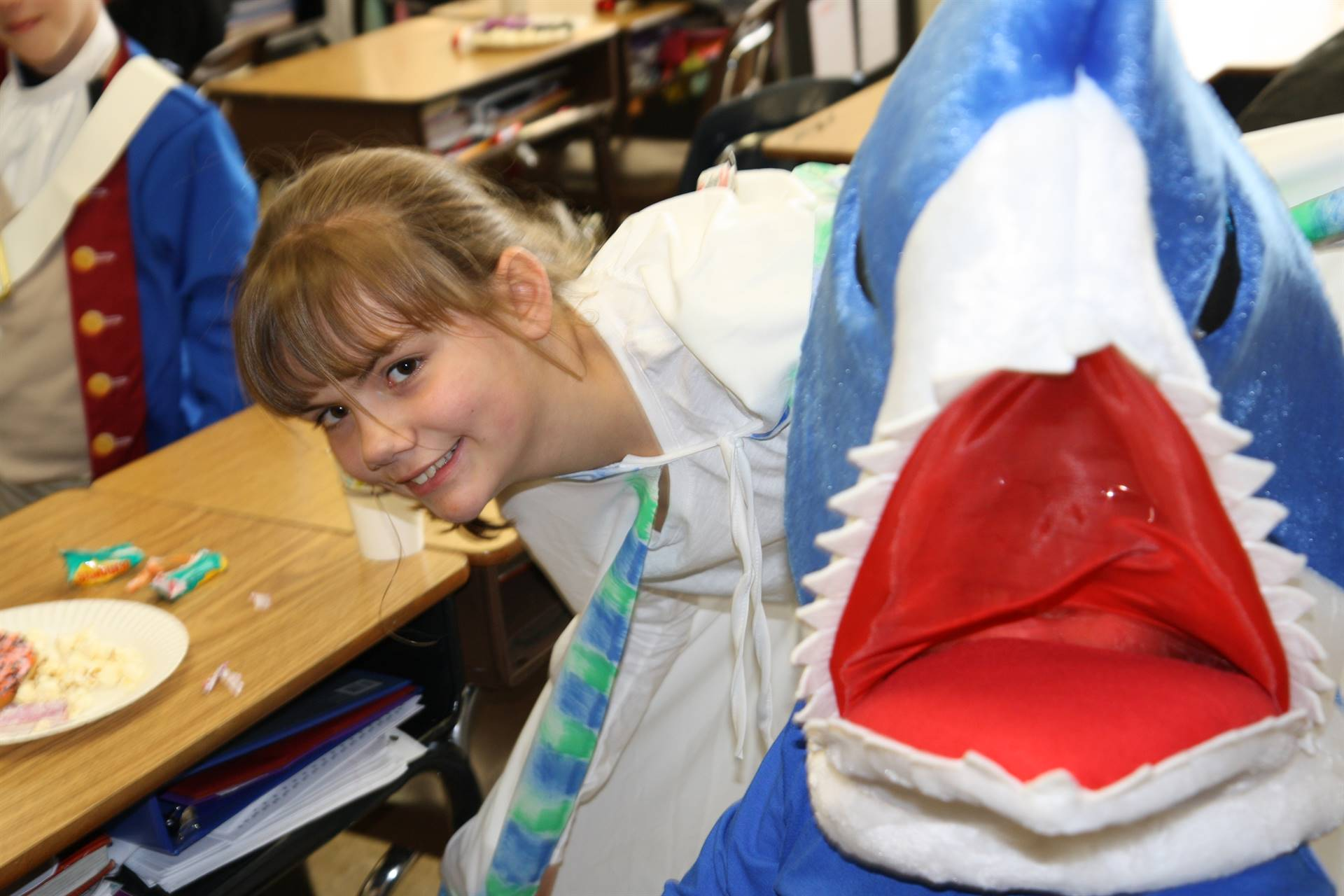 student next to another student dressed as a shark