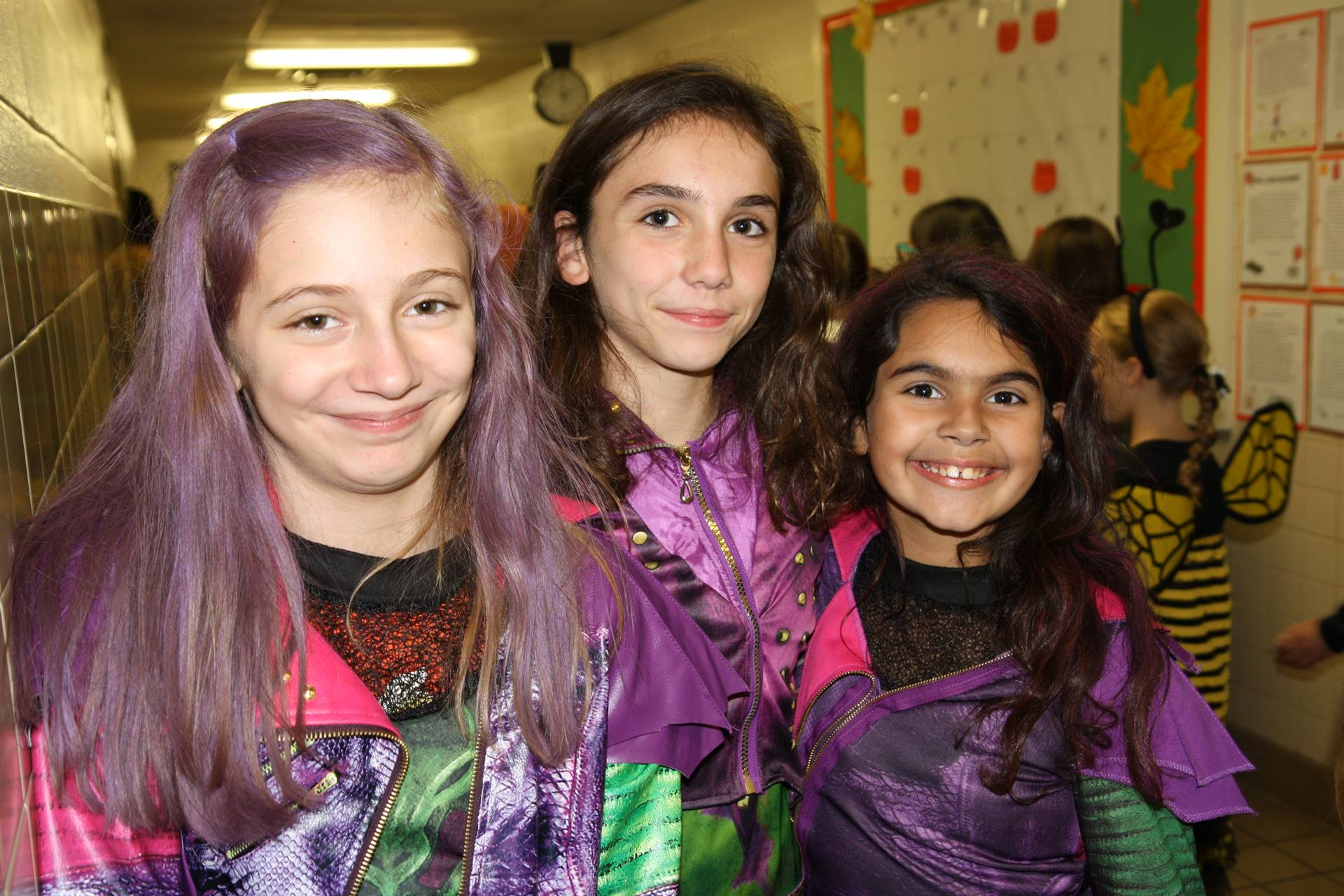 three girls dressed up for halloween event