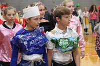 students dressed as water bottles for middle school costume contest