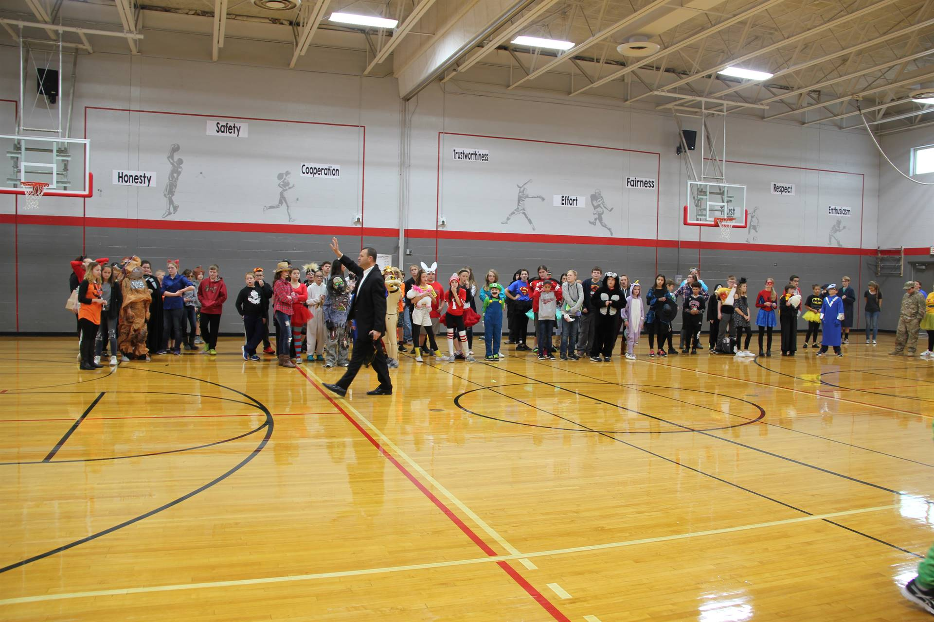 wide shot of students in gym for middle school costume contest