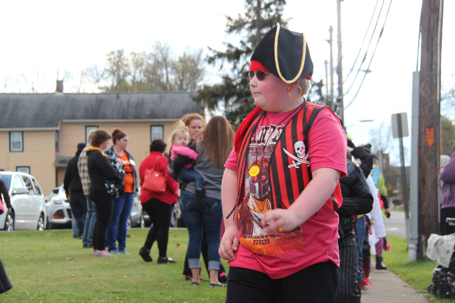 boy dressed as pirate for halloween parade