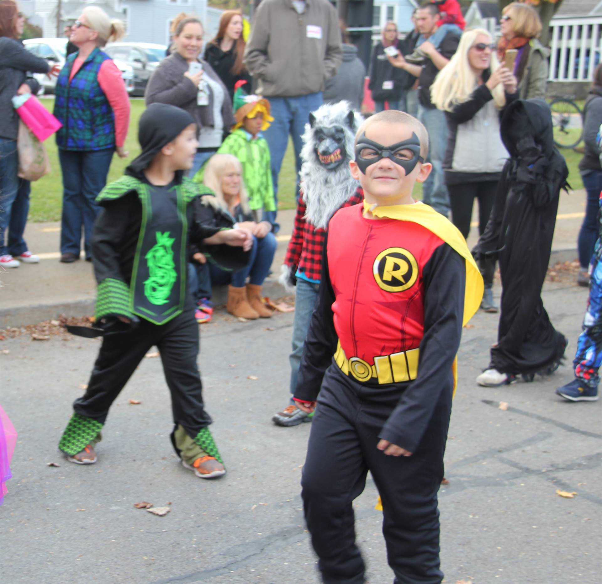 boy dressed as robin from batman