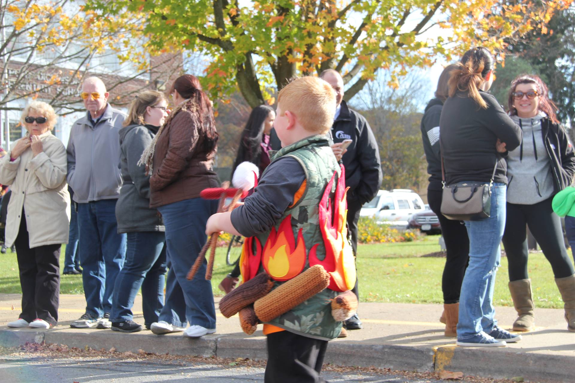 boy dressed as campfire with smore for halloween parade