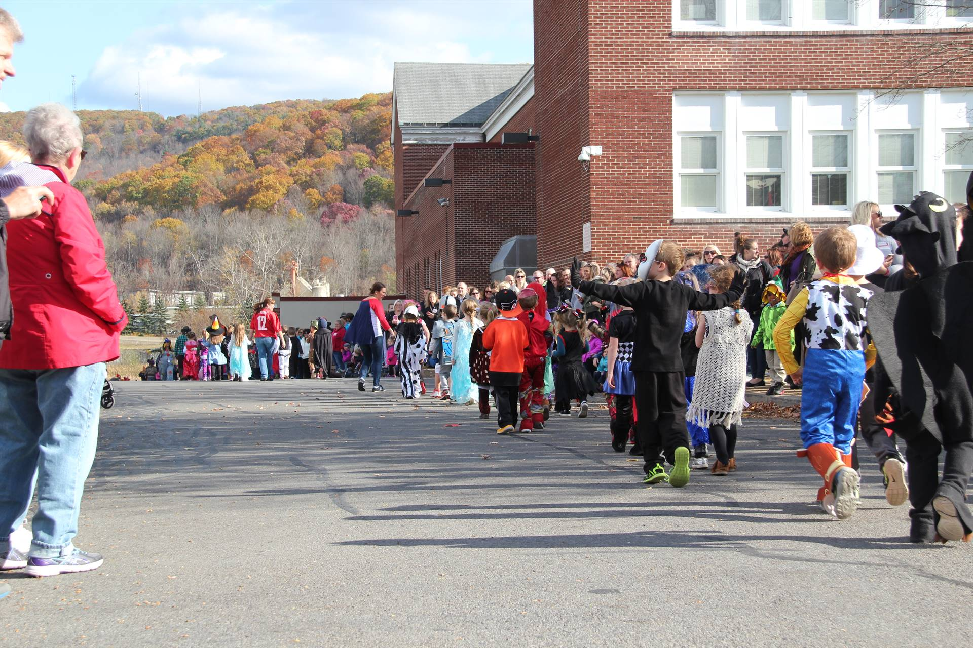 long line of students in halloween parade