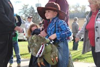 student dressed as cowboy riding dinosaur