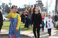 students dressed in costumes for parade