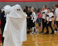 student dressed as ghost for middle school costume contest