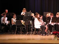 students from seventh and eighth grade band performing