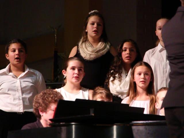 students singing medium shot