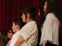 students singing up close