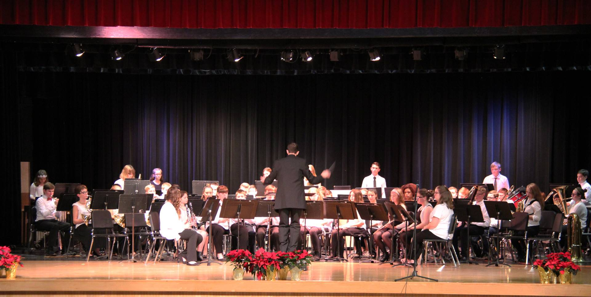 seventh and eighth grade band performing on stage