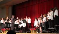 sixth grade chorus singing on stage