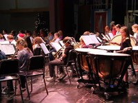 students playing instruments from stage view