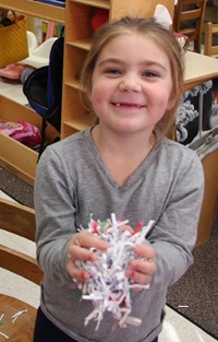 girl holding paper confetti