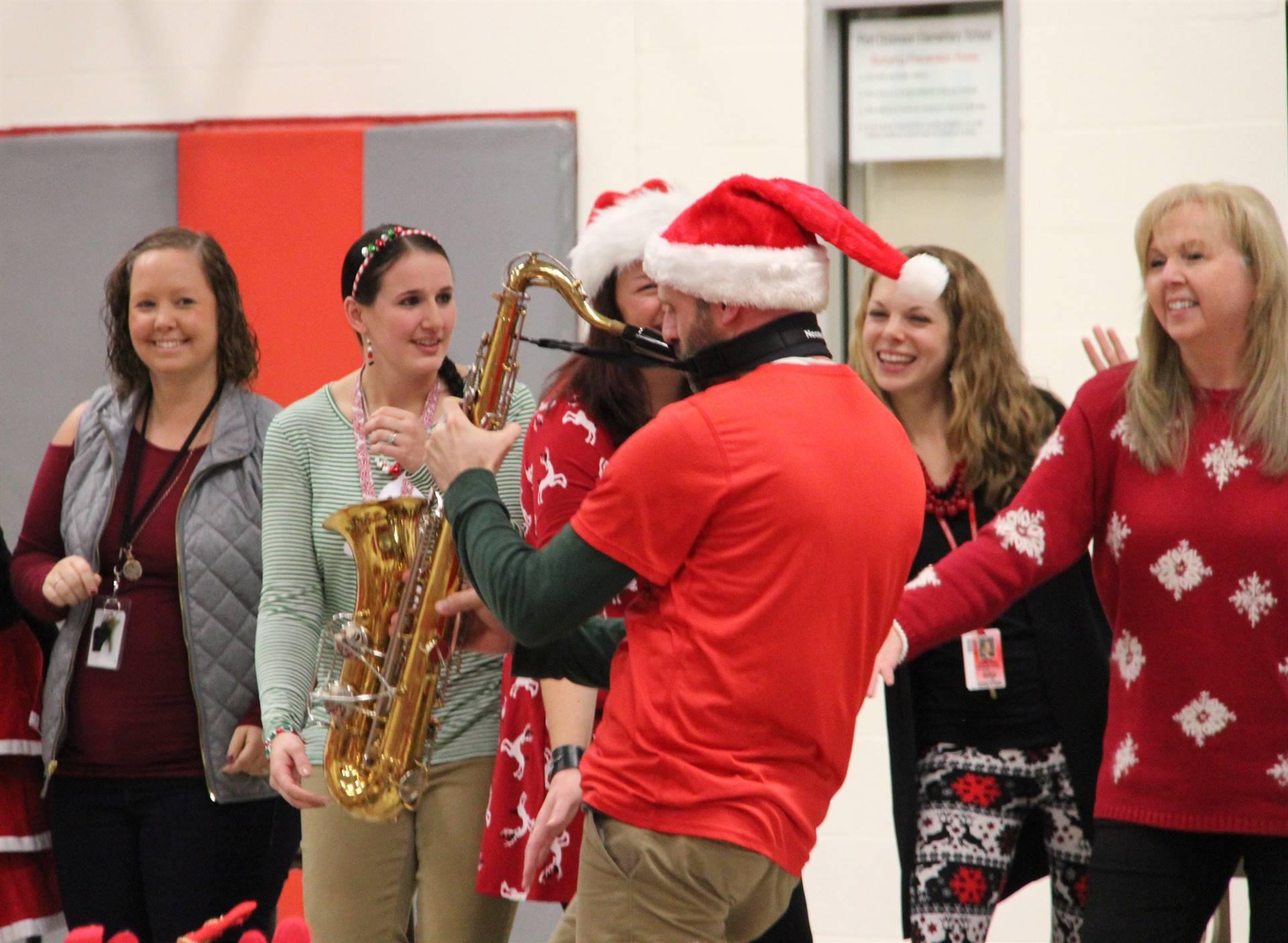 teacher playing saxophone
