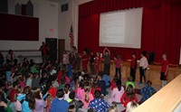 students perform skit to holiday song