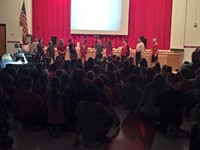 students singing song