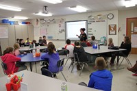 far shot of students learning about literacy