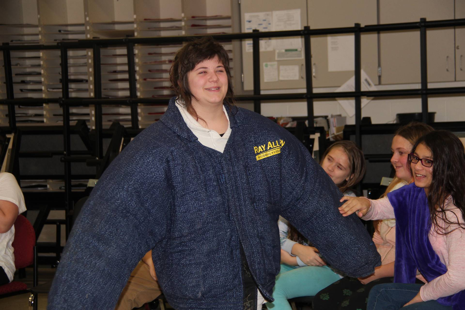 student demonstrating what a jacket looks like
