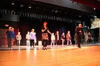 students learn salsa dancing