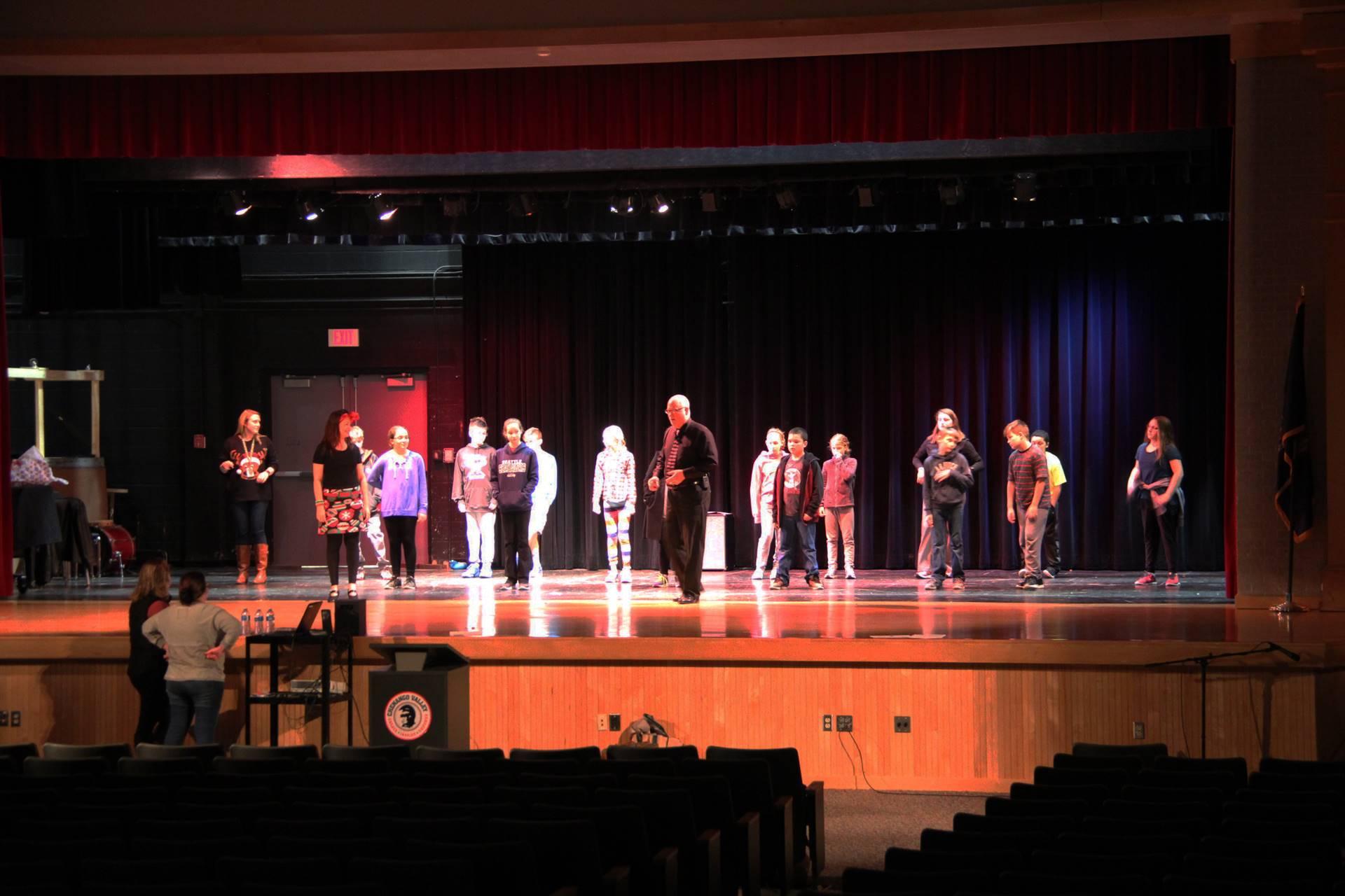 far shot of students learning salsa dancing