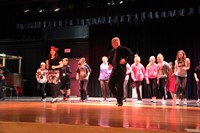 students salsa dance on stage