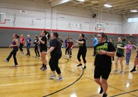 students doing zumba in gym