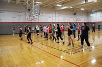 far shot of students salsa dancing