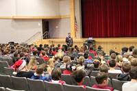 joel bennett talking to students far shot