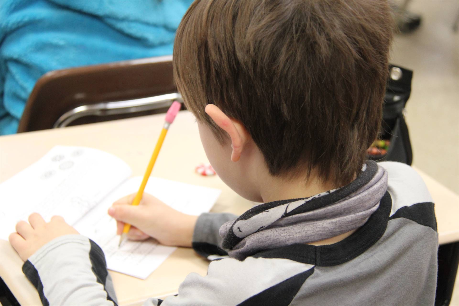 student writing on paper